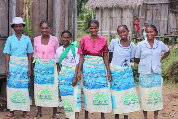 Women's group enrolled in the health project. They are wearing 'lambahoany' (sarongs) given to each household. Each 'lambahoany' always has a Malagasy proverb. This one says 'Ny atiala velogno dia loharanon'ny fahasalamanan-tena' (A living forest is the source of your own health). Photo courtesy of Christopher Golden.