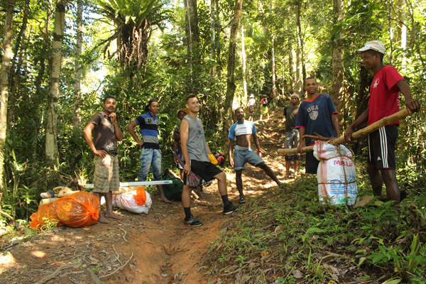 The paths to many of the forest communities in are very demanding physically. A cold chain for blood samples using liquid nitrogen must be hiked in from the coast where the road ends. Photo by: Christopher Golden/WCS.
