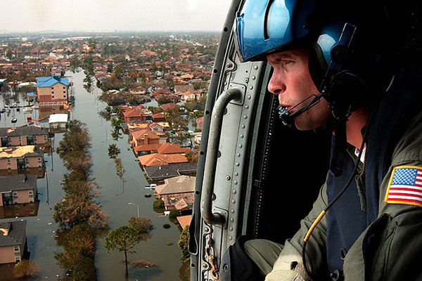 U.S. Coast Guard looks for survivors after New Orleans flooded during Hurricane Katrina. Photo by: U.S. Coast Guard Petty Officer 2nd Class NyxoLyno Cangemi.