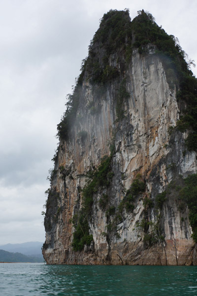 Limestone karst rising out of Cheow Lan Lake. Photo by: Greg McCann.