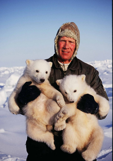 Steven Amstrup with a pair of polar bears during a research expedition. Photo courtesy of Steven Amstrup.