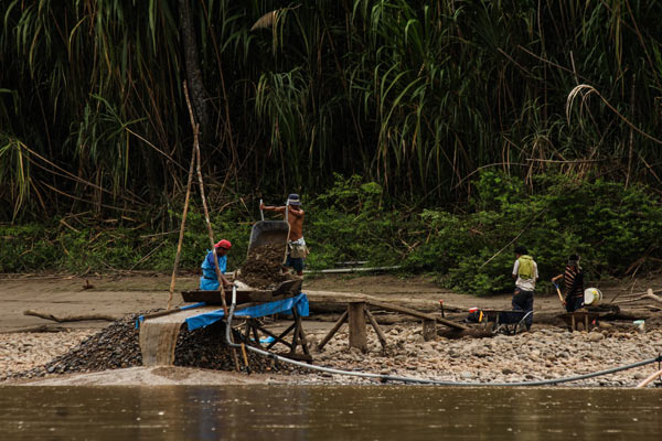 Gold mining along the Madre de Dios River, destroying the land, and poisoning the rivers. Photo courtesy of Paul Rosolie.