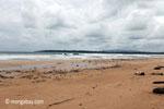 Indian ocean waves breaking on a beach in Ujung Kulon