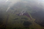 Aerial vew of burning peatlands in Indonesia's West Kalimantan province [kalbar_1204]