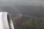 Airplane vew of burning peatlands and forest in Indonesian Borneo [kalbar_1245]