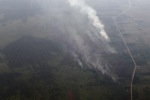 Airplane vew of burning peatlands and forest in Indonesian Borneo [kalbar_1259]