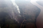 Aerial vew of burning peatlands and forest in Indonesian Borneo