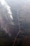 Airplane vew of burning peatlands and forest in Indonesian Borneo
