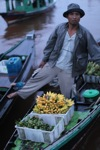 Man selling bananas at the floating market in Banjarmasin [kalsel_0208]