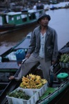 Man selling bananas at the floating market in Banjarmasin