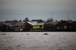 Homes along the Barito river in Banjarmasin