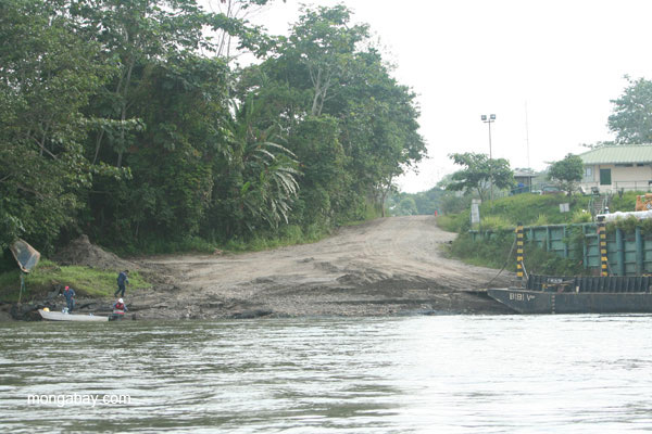 Oil infrastructure and workers on the Napo River in the Ecuadorian Amazon