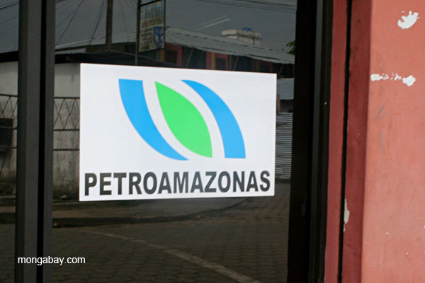 Sign for oil company in the frontier town of Coca in the Ecuadorian Amazon