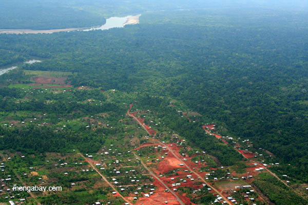 Aerial view of edge of Coca and rainforest beyond in the Ecuadorian Amazon