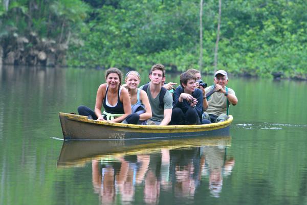 American undergraduates touring ox-bow lake in Yasuni National Park in the Ecuadorian Amazon