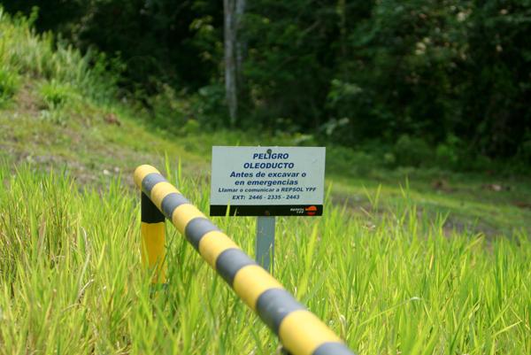 Repsol YPF oil pipeline sign in Yasuni National Park in the Ecuadorian Amazon