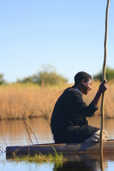 Boy in mokoro boat in Botswana. Photo by: Tiffany Roufs.