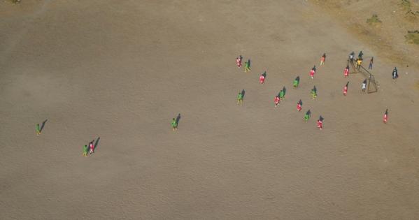 Football match from above near the Okavango delta