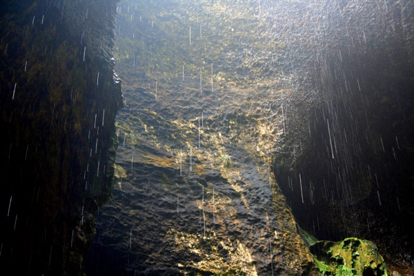 Water falling from an overhead opening in the Gomantong Cave in Sabah, Malaysia