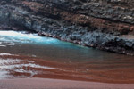 Secret red sand beach near Hana
