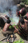 Tribal Dani women cooking sweet potato [papua_0604]