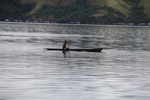 Man canoeing in Lake Sentani