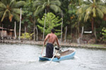 Sentani man in a fishing canoe