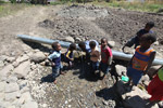 Papuan kids drinking out of a leaking water pipe [papua_5113]