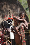 Dani child on his mother's shoulders [papua_5643]