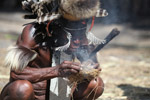 Dani man starting a fire with fiber and kindle [papua_5667]