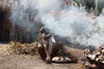 Dani man roasting a pig [papua_5815]
