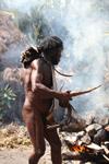 Dani man roasting a pig [papua_5822]