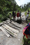 Papuans reparing a hole in the road using boards [west-papua_0608]