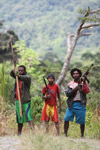 Armed clansmen in New Guinea