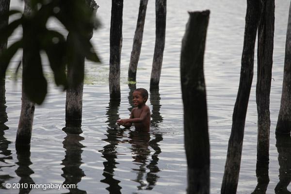 Boy playing in Lake Sentani [papua_1022]