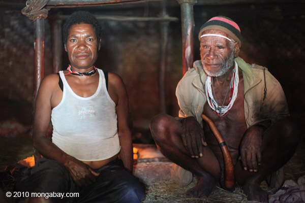 Lani men in a hut in Indonesian New Guinea. Photo by Rhett A. Butler.