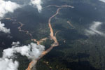River discolored by mine waste in the Amazon rainforest