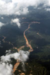 River muddied by mine waste in the Amazon rainforest