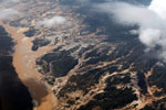 Overhead view of the Río Huaypetue gold mine in Peru [peru_aerial_0162]