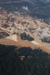 Airplane view of deforestation caused by the Río Huaypetue gold mine in the Peruvian Amazon