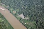 Overhead photo of cattle pasture cleared along a river in the Peruvian Amazon