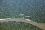 Overhead photo of cattle pasture cleared along a river in Peru's Amazon