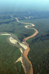 Polluted river entering a rainforest river
