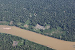 Airplane view of deforestation along a river in Peru's southeastern Amazon region