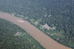 Overhead view of deforestation along a river in the Peruvian Amazon