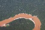 Orange-red colored river in the Amazon rainforest