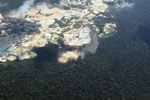 Amazon rainforest landscape scarred by open pit gold mining