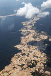 Plane view of Amazon rainforest landscape scarred by open pit gold mines