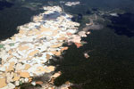 Aerial view of Amazon rainforest landscape scarred by open pit gold mines