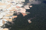 Airplane view of Amazon landscape scarred by open pit gold mining